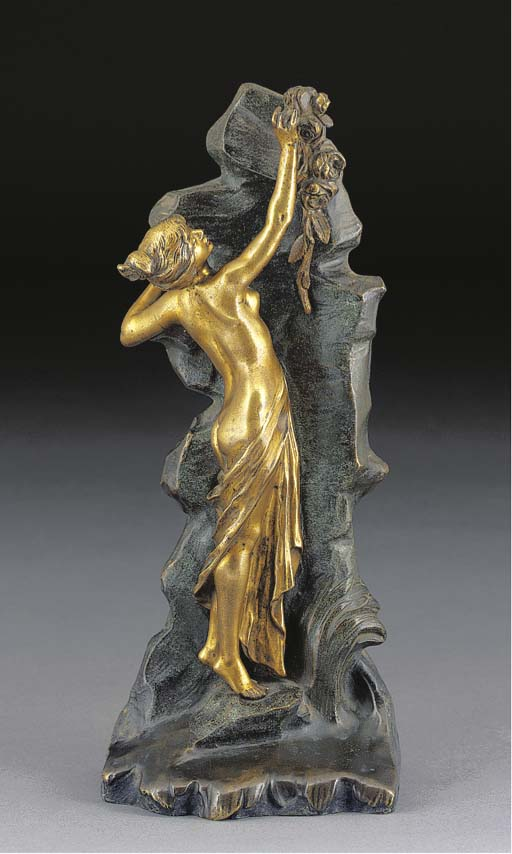 A PATINATED FIGURAL BRONZE