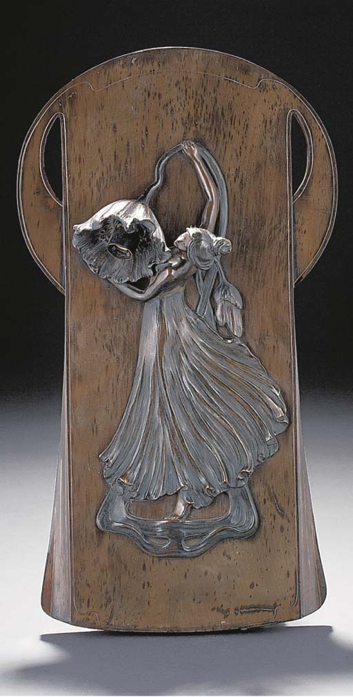 A PATINATED FIGURAL BRONZE WAL