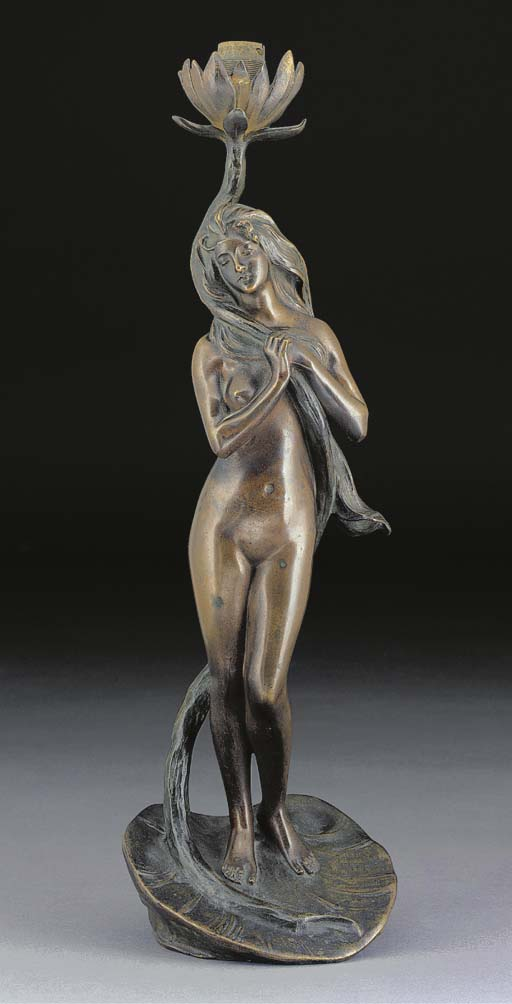 A PATINATED FIGURAL BRONZE TAB