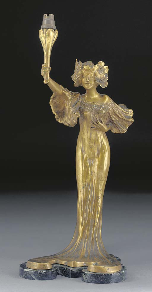 A PATINATED BRONZE FIGURAL TAB