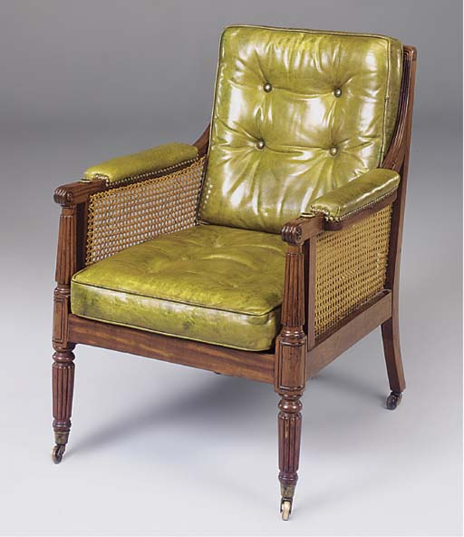 A GREEN LEATHER UPHOLSTERED BE