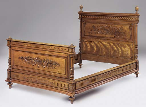 A FRENCH WALNUT BEDSTEAD