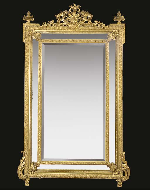 A FRENCH GILTWOOD AND GILT COM