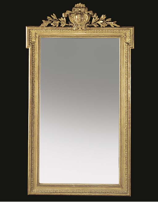 A FRENCH COMPOSITION GILT OVERMANTEL MIRROR
