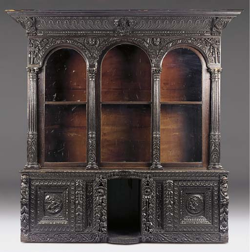 A LARGE CARVED OAK LIBRARY BOO