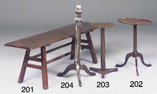 A mahogany and oak tripod table