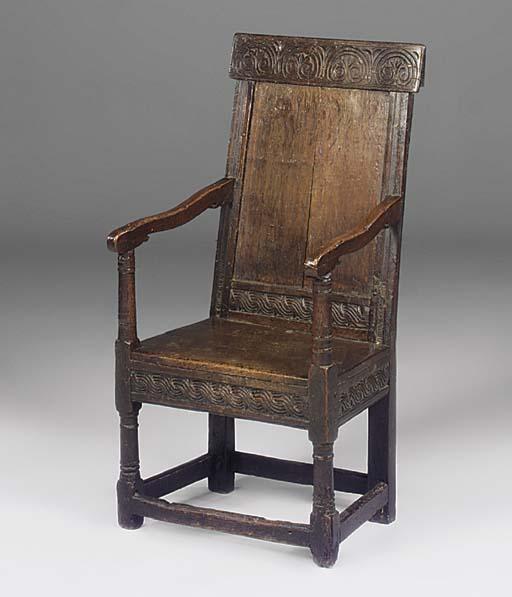 An English oak panel back open armchair