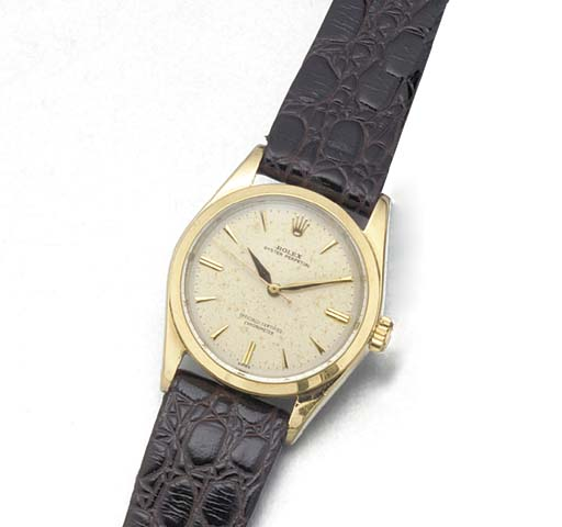 ROLEX: A STEEL AND GILT AUTOMA