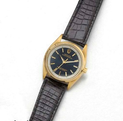 ROLEX: A 14ct. GOLD AUTOMATIC