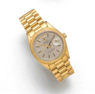 ROLEX: AN 18ct. GOLD AUTOMATIC