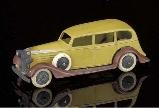 A pre-war Dinky two-tone brown