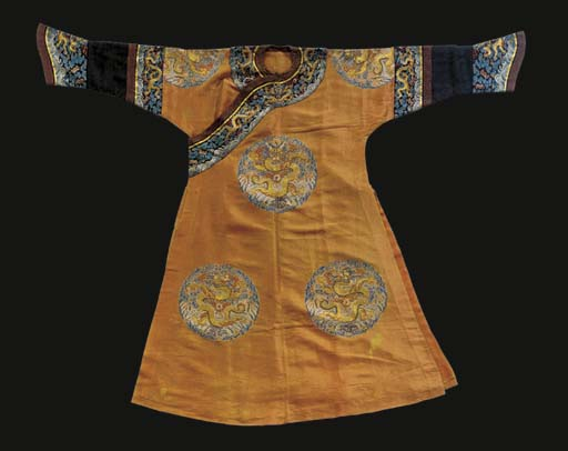 An imperial consort's long pao of apricot silk gauze, embroidered in silks in counted stitch and in couched gilt thread with eight dragon roundels, with borders, wide horse-shoe cuffs and additional sleevebands of black silk gauze similarly worked with dragons and clouds, trimmed with brown satin brocaded bindings, 19th century, some stains, tears and repairs, sleeves possibly shortened, taken up at hem