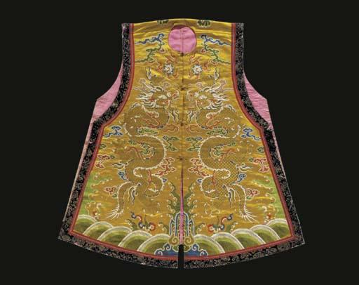 A sleeveless surcoat (chao gua) of yellow silk brocade, the