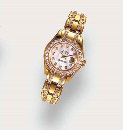 ROLEX, A LADY'S 18CT YELLOW GO