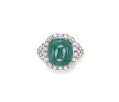 A CABOCHON EMERALD AND DIAMOND