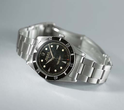 Rolex. A very rare stainless steel self-winding waterproof wristwatch with sweep centre seconds, bracelet and black honeycomb dial