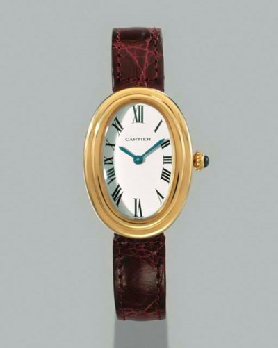 Cartier. An 18K gold oval wris