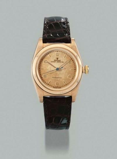 Rolex. A 14K pink gold self-wi