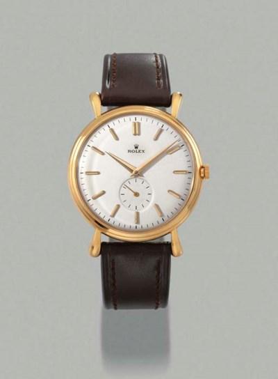 Rolex. A large 18K gold self-w