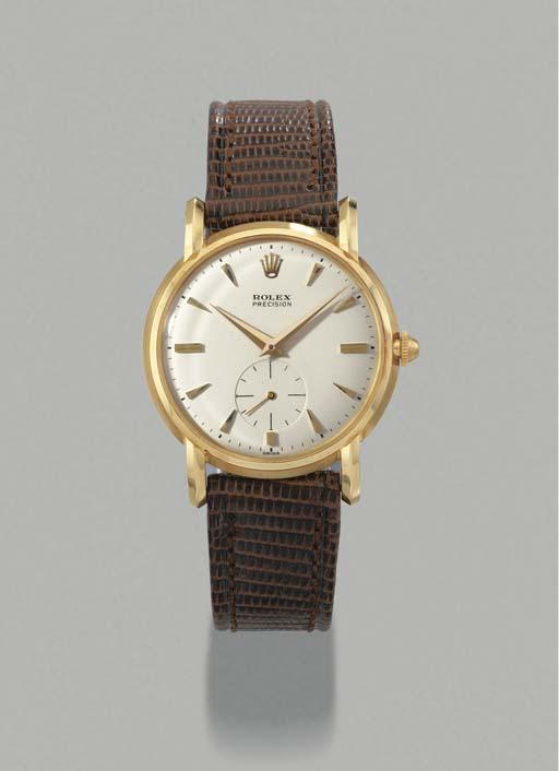 Rolex. An 18K gold wristwatch