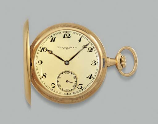 Patek Philippe. An 18K gold hunter case keyless lever watch with Breguet numerals