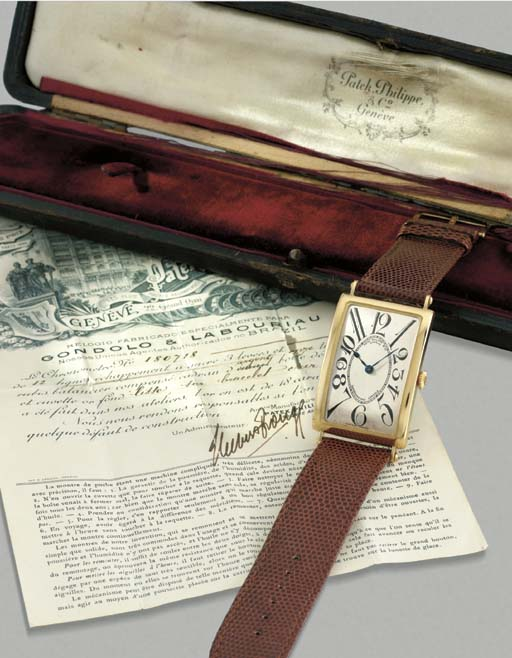 Patek Philippe. An important 18K gold oversized rectangular hinged wristwatch with original certificate and box