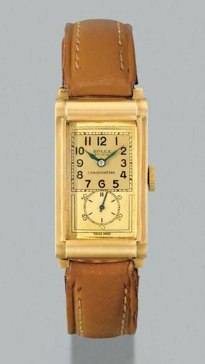 Rolex. A fine 14K gold rectang