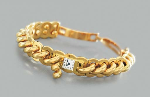 Cartier. A lady's fine and unusual 18K gold backwound bracelet watch