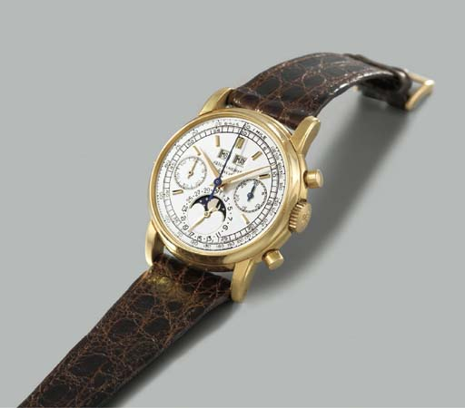Patek Philippe. A very fine and rare 18K gold perpetual calendar chronograph wristwatch with phases of the moon
