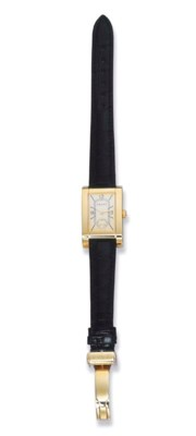 AN 18K YELLOW GOLD WRIST WATCH
