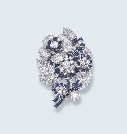 AN ELEGANT SAPPHIRE AND DIAMOND FLORAL BROOCH, BY CARTIER
