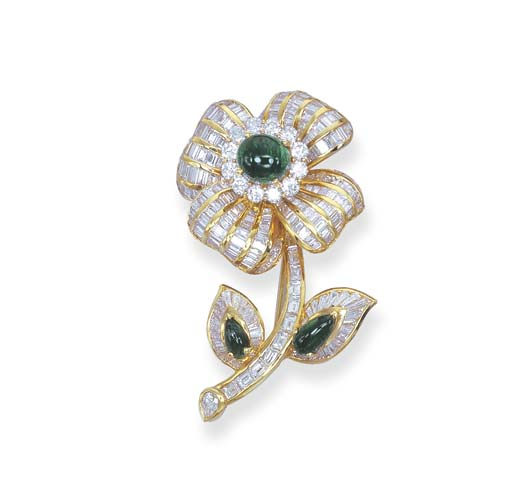 AN EMERALD AND DIAMOND FLORAL