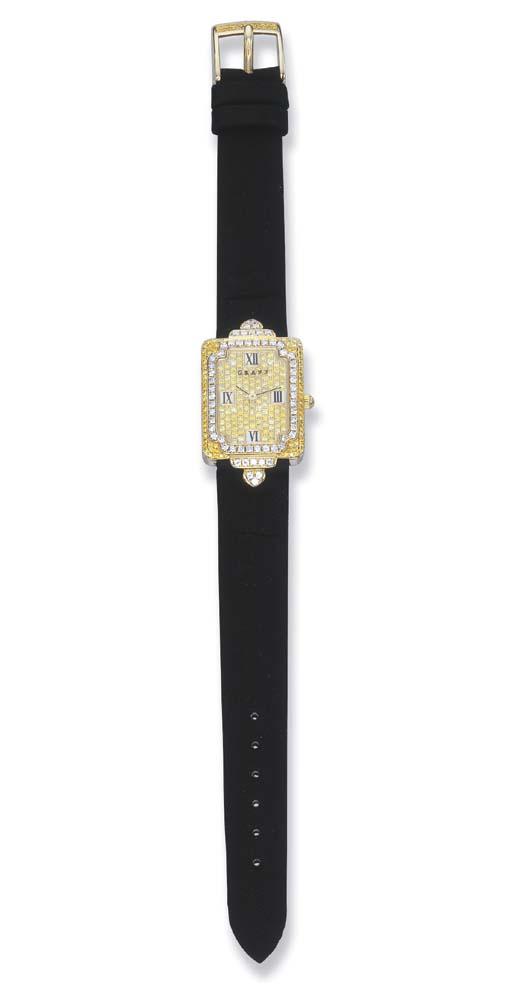 A YELLOW DIAMOND AND DIAMOND W