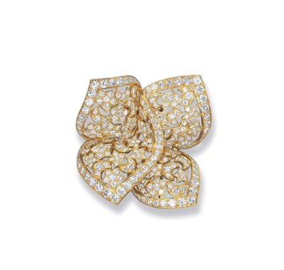 A DIAMOND 'SIRIUS' BROOCH, BY