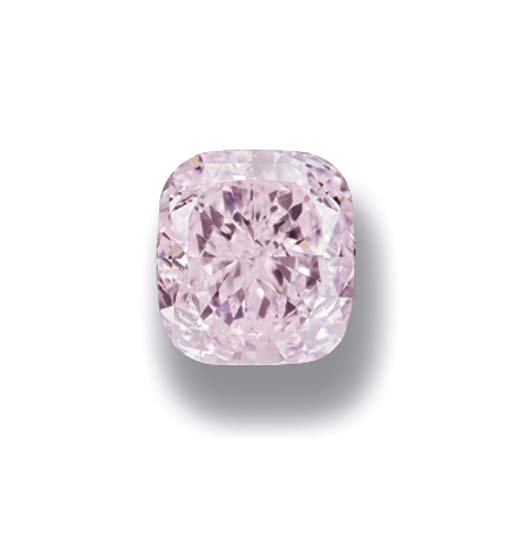 A RARE FANCY PURPLISH PINK DIAMOND SINGLE-STONE RING