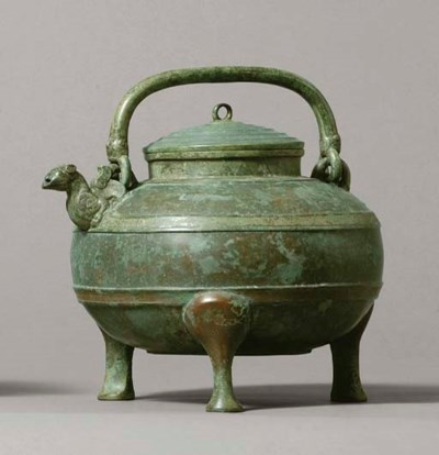 A BRONZE WINE EWER AND COVER,