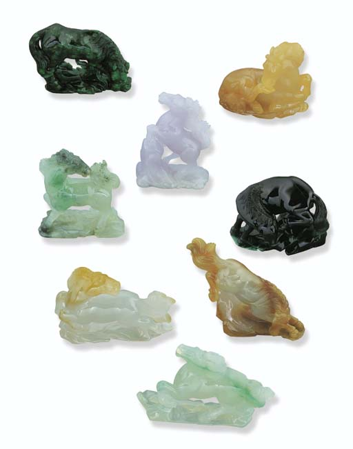 A GROUP OF CARVED JADEITE HORS