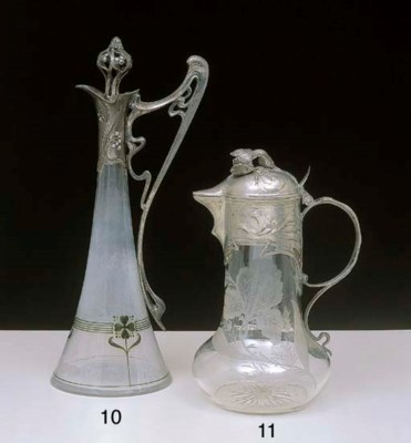 AN ART NOUVEAU PEWTER MOUNTED