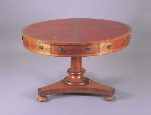A VICTORIAN OAK DRUM TABLE