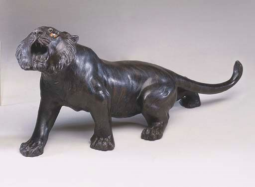 A JAPANESE BRONZE OF A ROARING