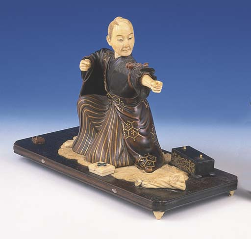 * A JAPANESE IVORY, WOODEN AND