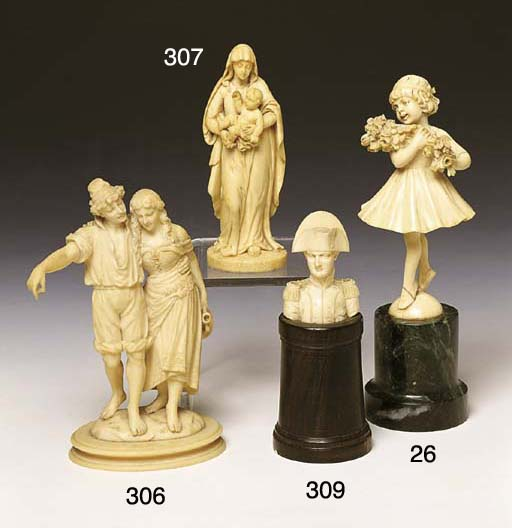 * AN ART DECO CARVED IVORY FIG
