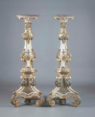 A LARGE PAIR OF CARVED AND GIL