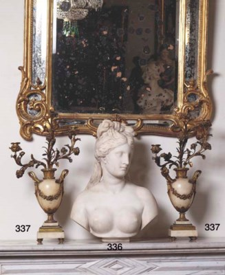 A WHITE MARBLE BUST OF VENUS