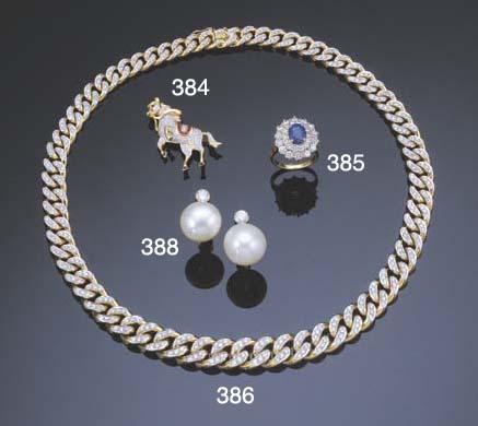 A DIAMOND AND GEMSTONE HORSE B