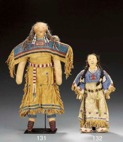 A SIOUX BEADED HIDE FEMALE DOL