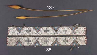 A PAIR OF SIOUX BEADED HIDE LE