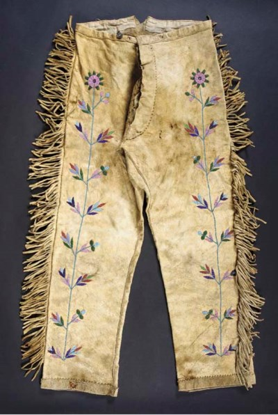 A PAIR OF SIOUX BEADED HIDE TR