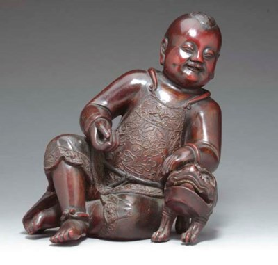 A LACQURED WOOD FIGURE OF LIUH