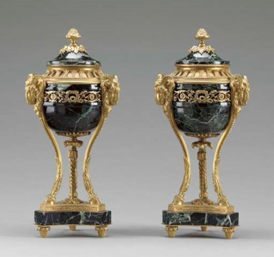 A pair of ormolu and verde ant